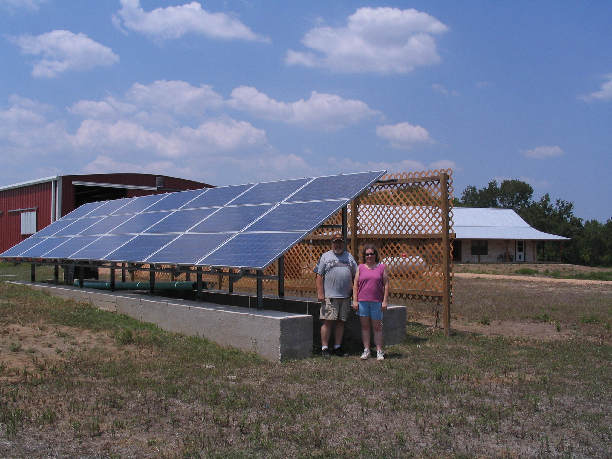 Kathryn and Mark Husband by 4kW Ground Mounted Array